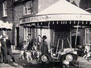 The Brewer family's juvenile ride in Brook Street in 1958, this ride can now be seen at Warwick's Victorian Evening with its current owner.